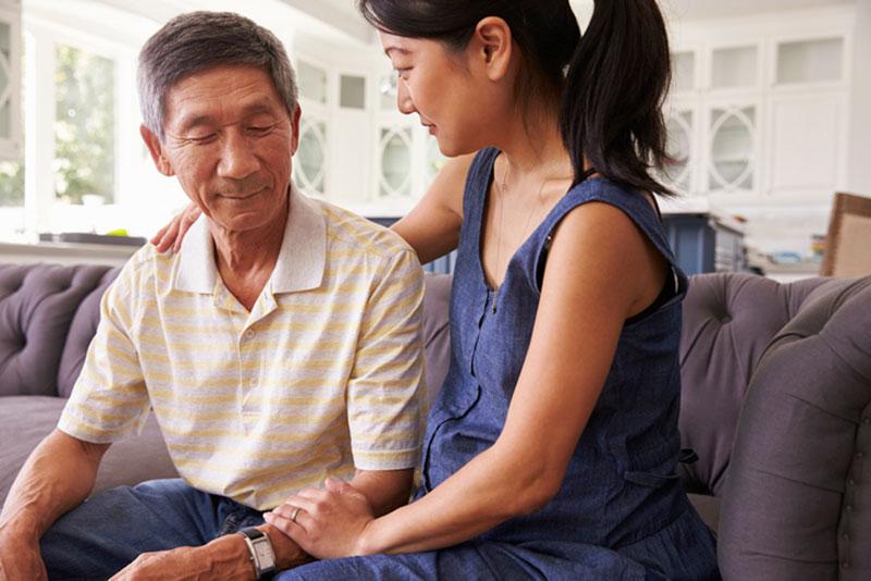 caregiver-comforting-senior-man